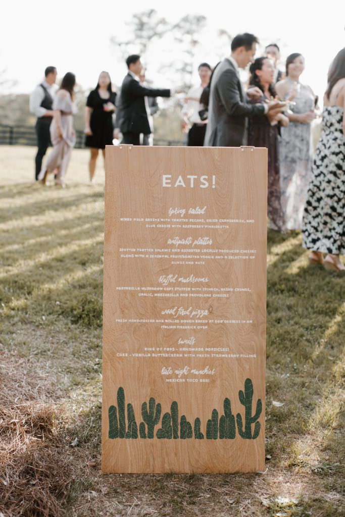 Wedding reception signage listing menu items