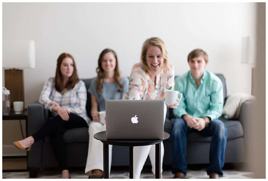 Group of people with a laptop - Wedding planner marketing tips