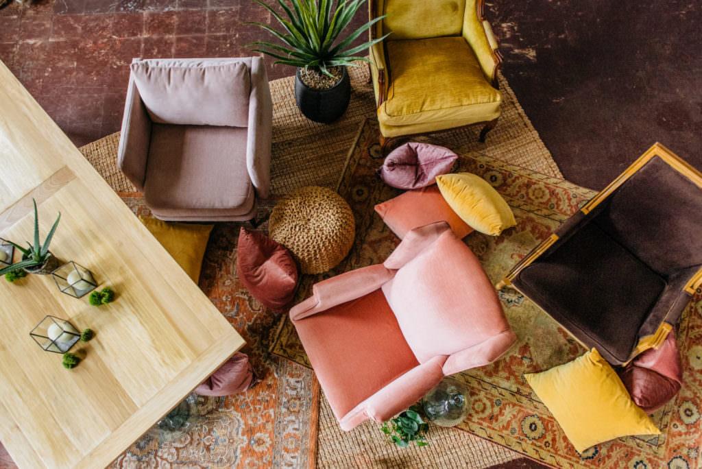 Fabric chairs, cushions, plant, rug, decor