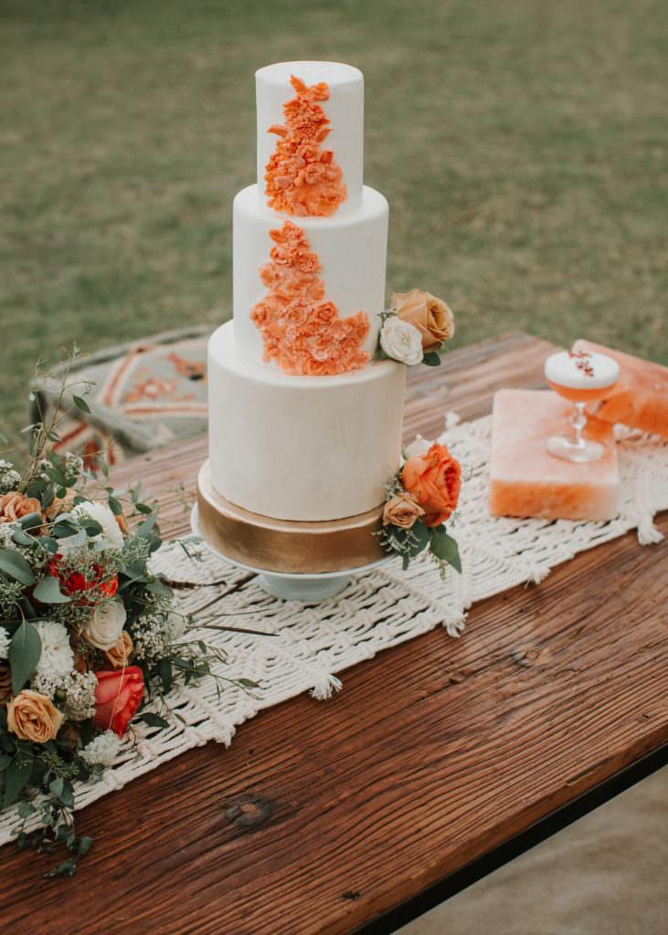 3 tier wedding cake with orange flowers