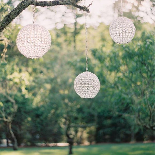 White circular lights hanging from a treee